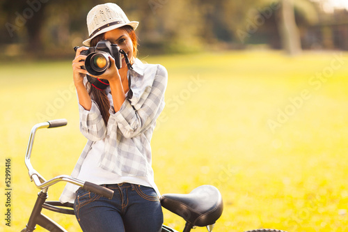 young woman taking photo outdoors