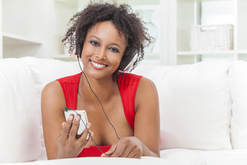 African American Girl Listening to MP3 Player Headphones