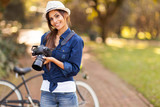 young female photographer with camera outdoors