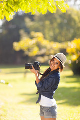 young photography student take photos outdoors