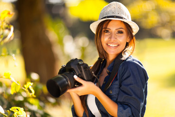beautiful female student photographer with camera