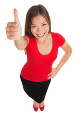 Happy woman giving a thumbs up gesture