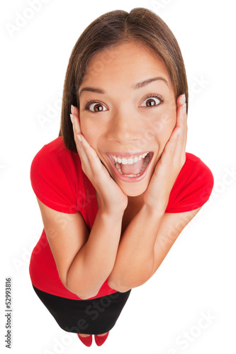 Joyful excited surprised young woman isolated