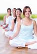Calm people doing yoga