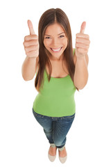 Young woman giving double thumbs up