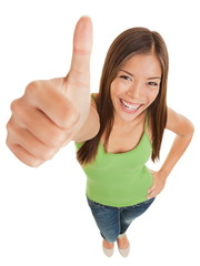 Fun portrait of a woman giving a thumbs up