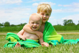 Brothers Hugging in Beach Towel