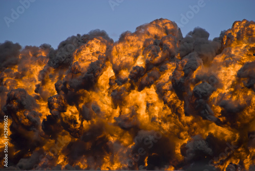Fiery explosion with thick black smoke.