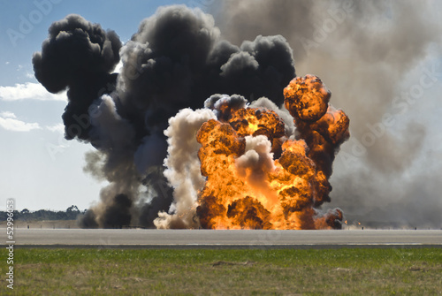 Aluminium Vuur / Vlam Fiery explosion with thick black smoke on an airport runway.