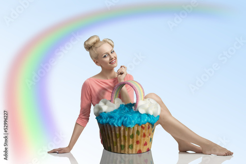 smiling girl with big cupcake
