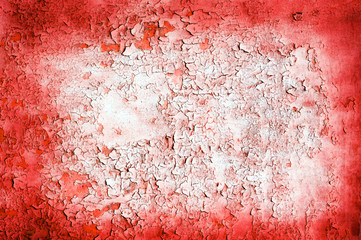 Red wall with old cracked paint