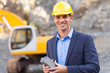 manager in mining site holding ore