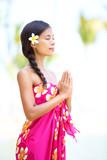 Meditating spiritual woman in meditation on beach