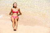 Beach vacation bikini girl sun tanning happy