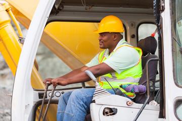 africa american man operates excavator