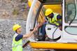 construction manager handshaking with bulldozer operator