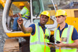 co-workers talking at construction site - 52997606