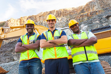 quarry workers standing with arms crossed