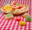 cookies and fruit candy  on the tablecloth