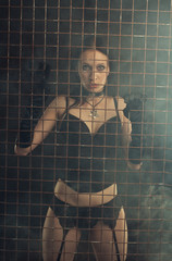 Sexy girl behind prison bars