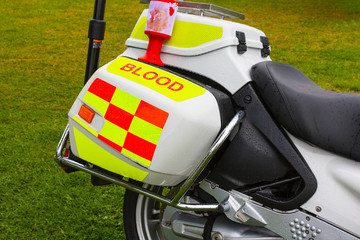 Charity collection tin on blood emergency delivery motorbike