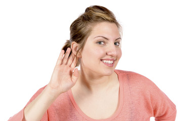 Listening woman with hand at ear