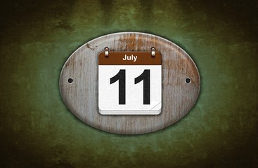 Old wooden calendar with July 11.
