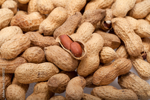 .Dried peanuts in closeup on the white background