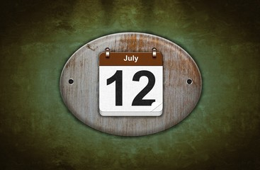 Old wooden calendar with July 12.