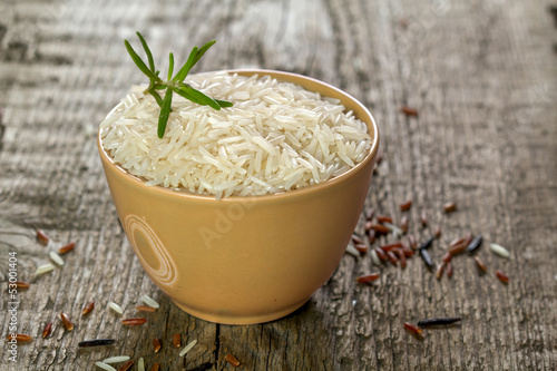 rice in a bowl with on wooden table