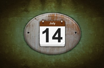 Old wooden calendar with July 14.