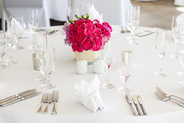 Dining table with pink flowers