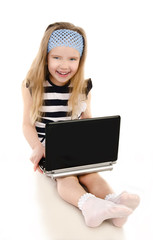 Smiling cute little girl with laptop isolated