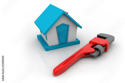 plumbers wrench  and house