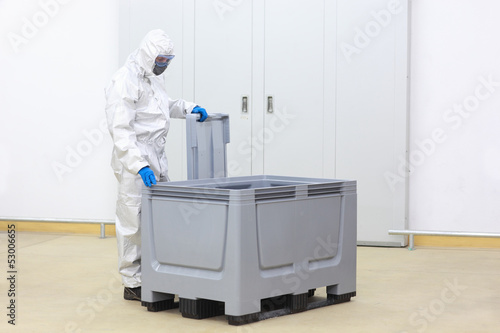 safety -  technician  checking contents of plastic container