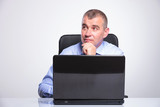 senior business man is pensive at laptop
