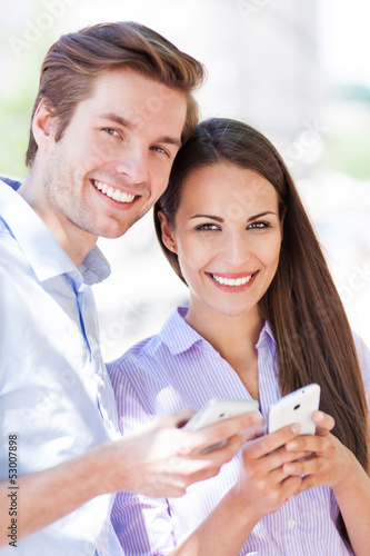 Couple with mobile phones
