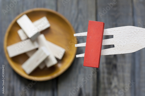 Unhealthy junk food creative concept comparison to wooden blocks