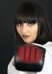 karateka asian girl on black background studio shot