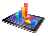 Business statistic concept - financial charts on tablet PC