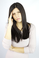 Woman with headache looking