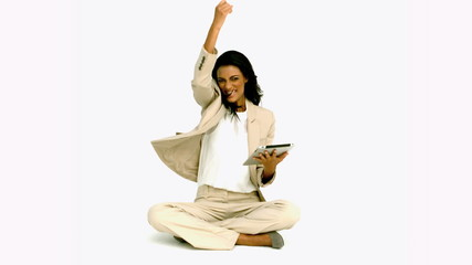 Woman cheering with her tablet on white background