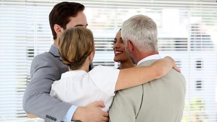 Business team hugging