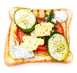 Fresh toast with bread, fried eggs, vegetables and cream, isolat