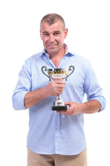 casual middle aged man holding trophy