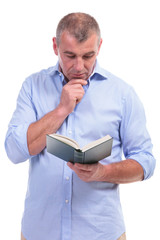 casual middle aged man reading attentive
