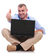 casual old man sits with laptop and shows ok