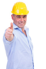 middle aged engineer showing thumbs up
