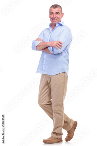 casual middle aged man with arms crossed