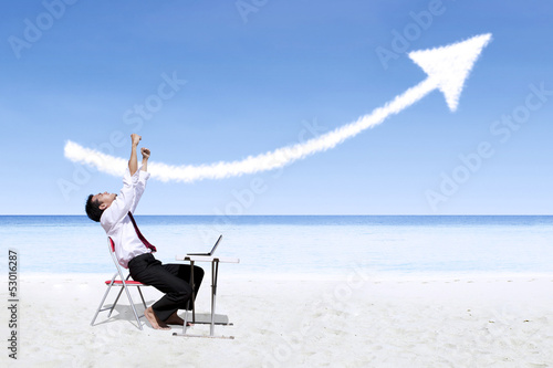 Businessman laughing looking at success arrow sign